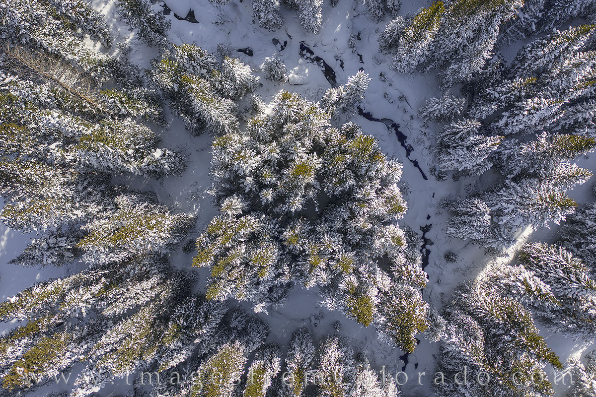 This aerial photograph shows Jim Creek just outside of Winter Park, Colorado, in Grand County. Recent snows had left the forest...