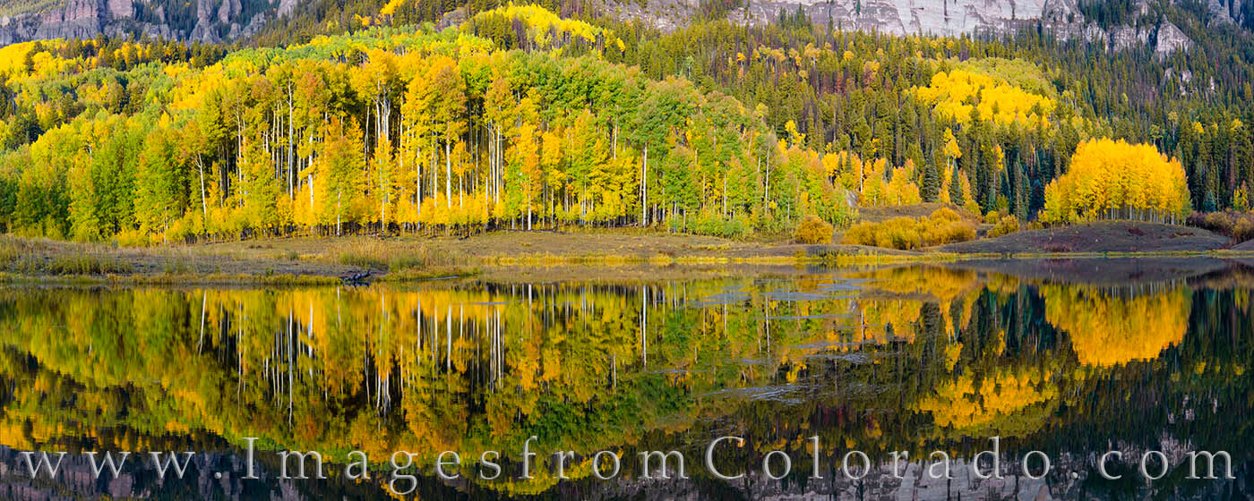 After a storm had passed, the waters of Clear Lake were absolutely still. The aspen were changing from green to gold, and the...