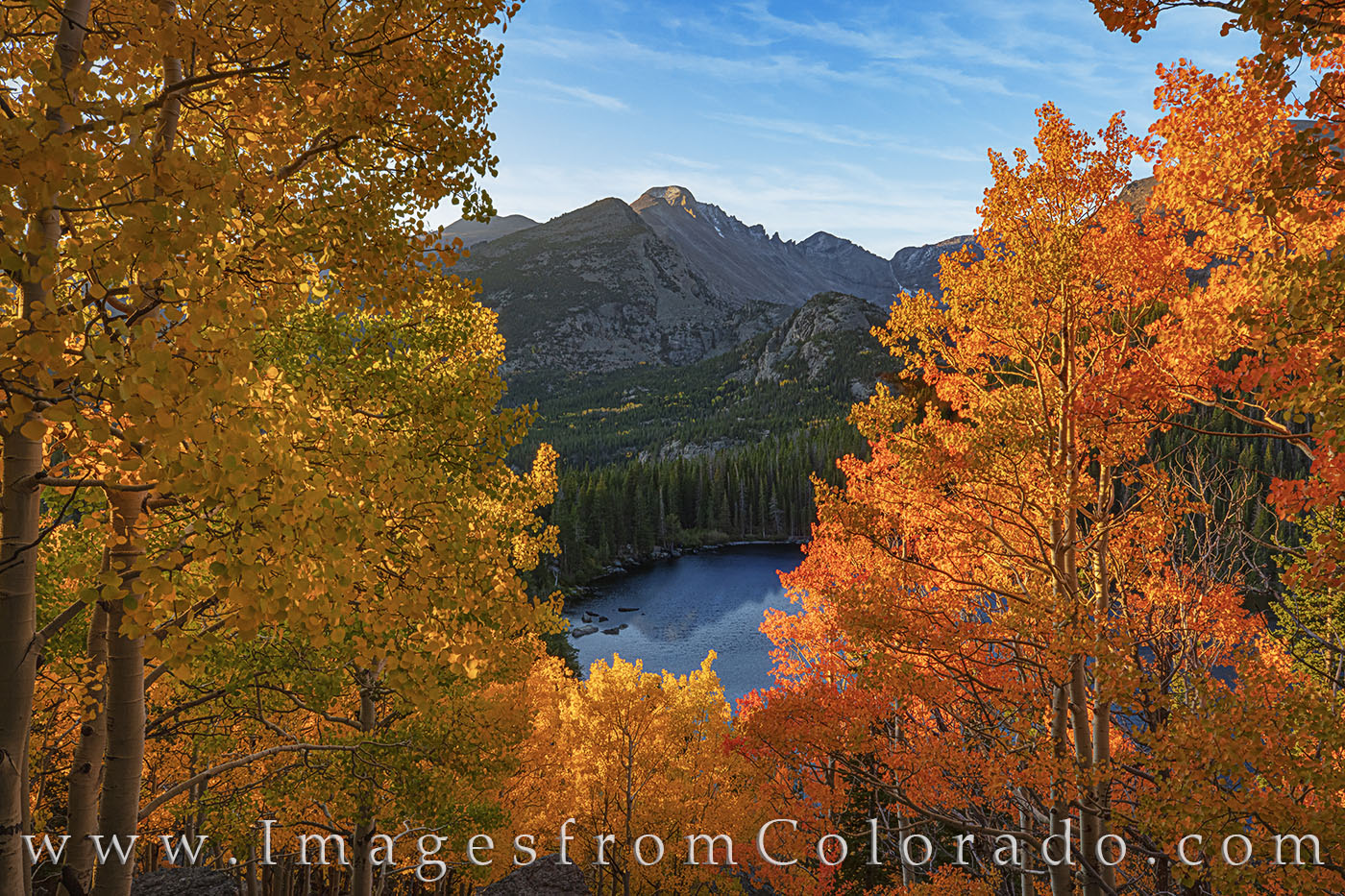 At the moment the first sunlight reaches the orange and gold aspen leaves above Bear Lake, the morning is suddenly ablaze in...