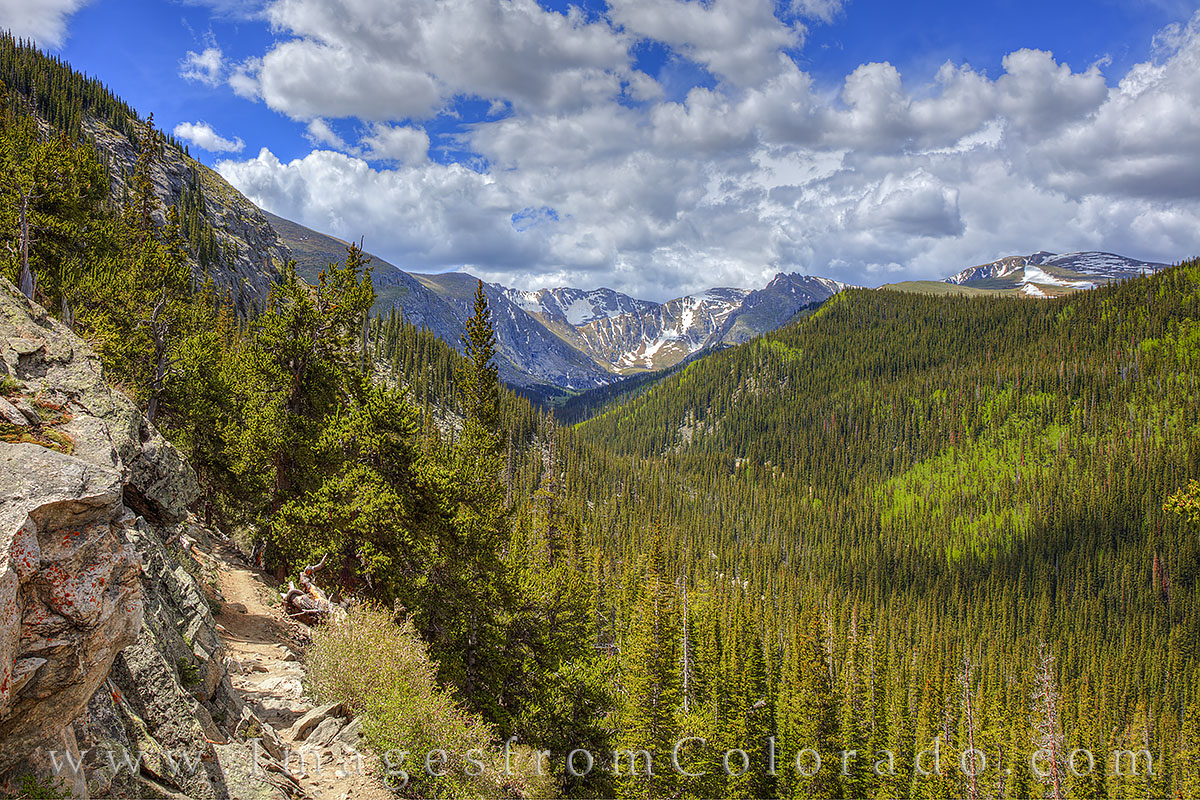 This photograph shows Mount Evans in the distance. On the left is a portion of the Chicago Lakes Trail as it begins to wind and...