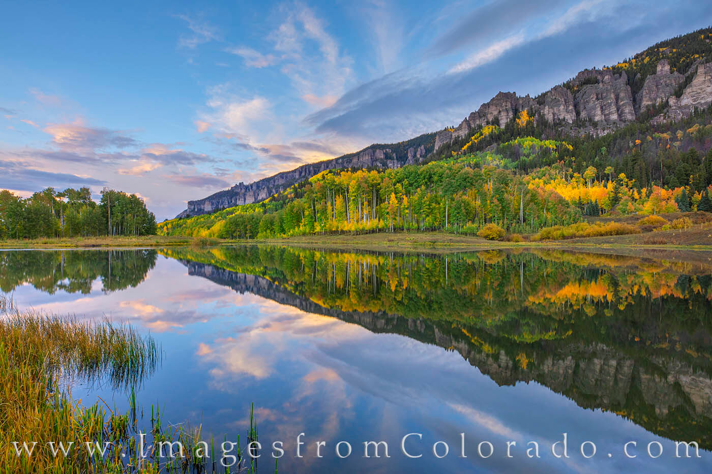 Early fall colors show up in the aspen along the edges of Clear Lake in the Cimarron Valley. A storm had just rolled through...