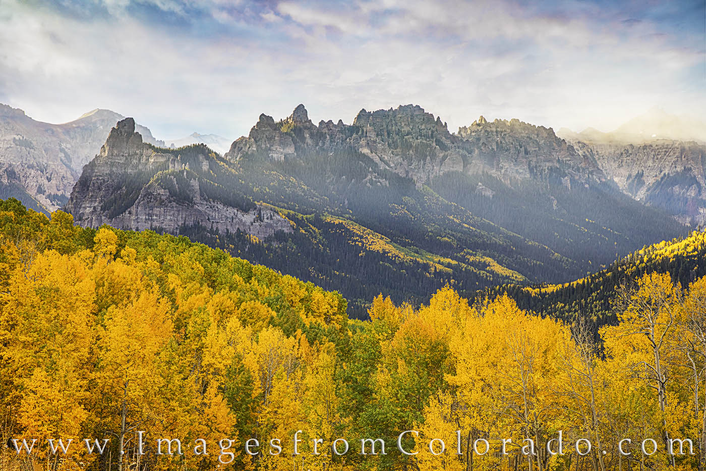 Low clouds swept across the jagged peaks of the Cimarron Range on this cold fall morning. The aspen were full of gold with patches...