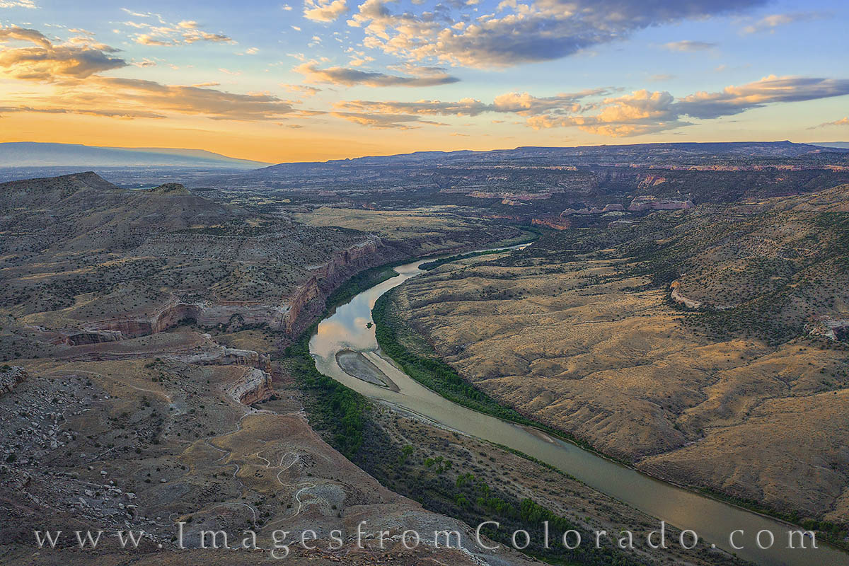 This aerial photograph looks east and shows the Colorado River at sunrise on a perfect July morning.