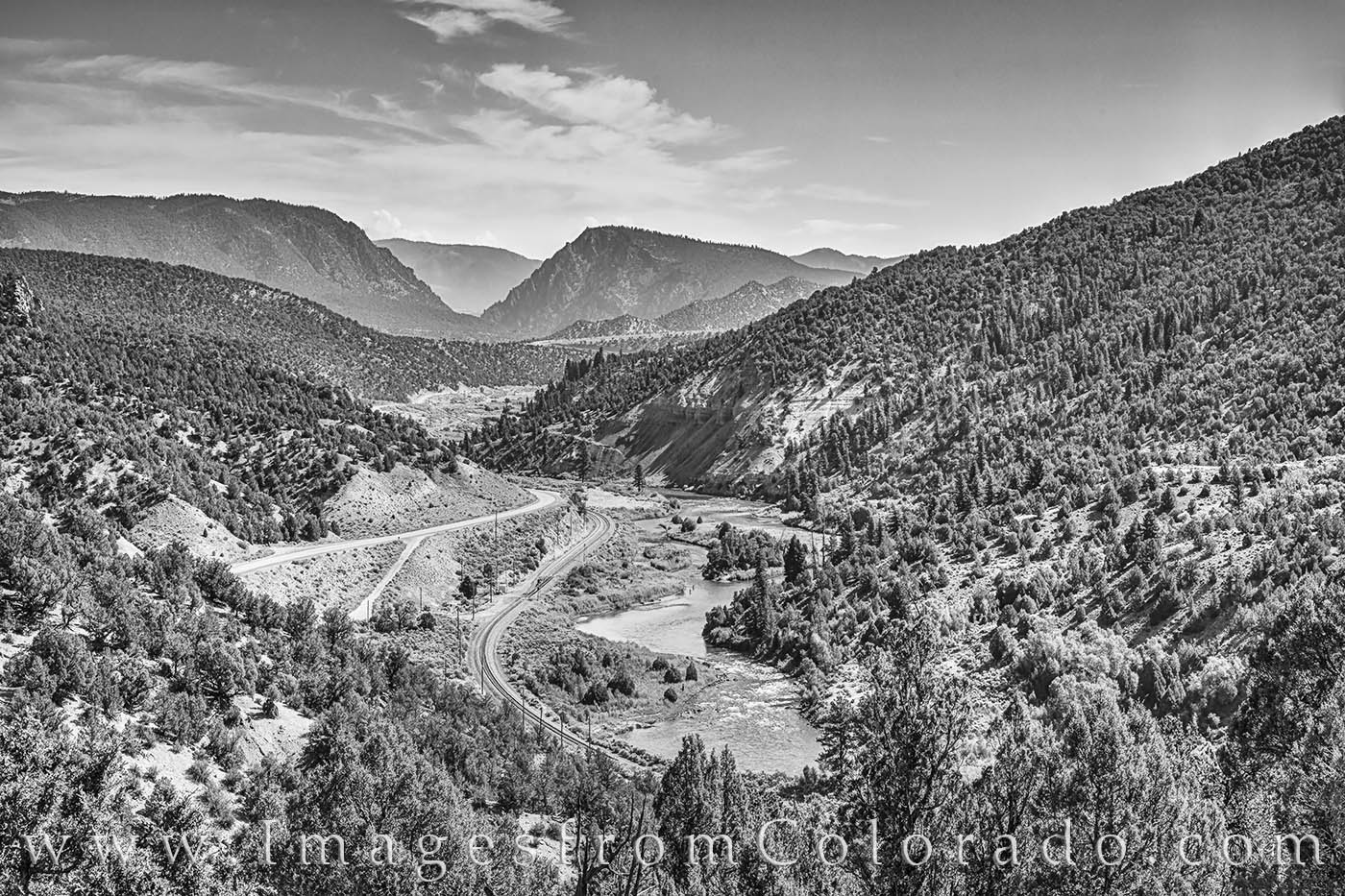 From the edge of Grand County, this black and white photo shows the Colorado River on a warm, summer afternoon. Trough Road is...