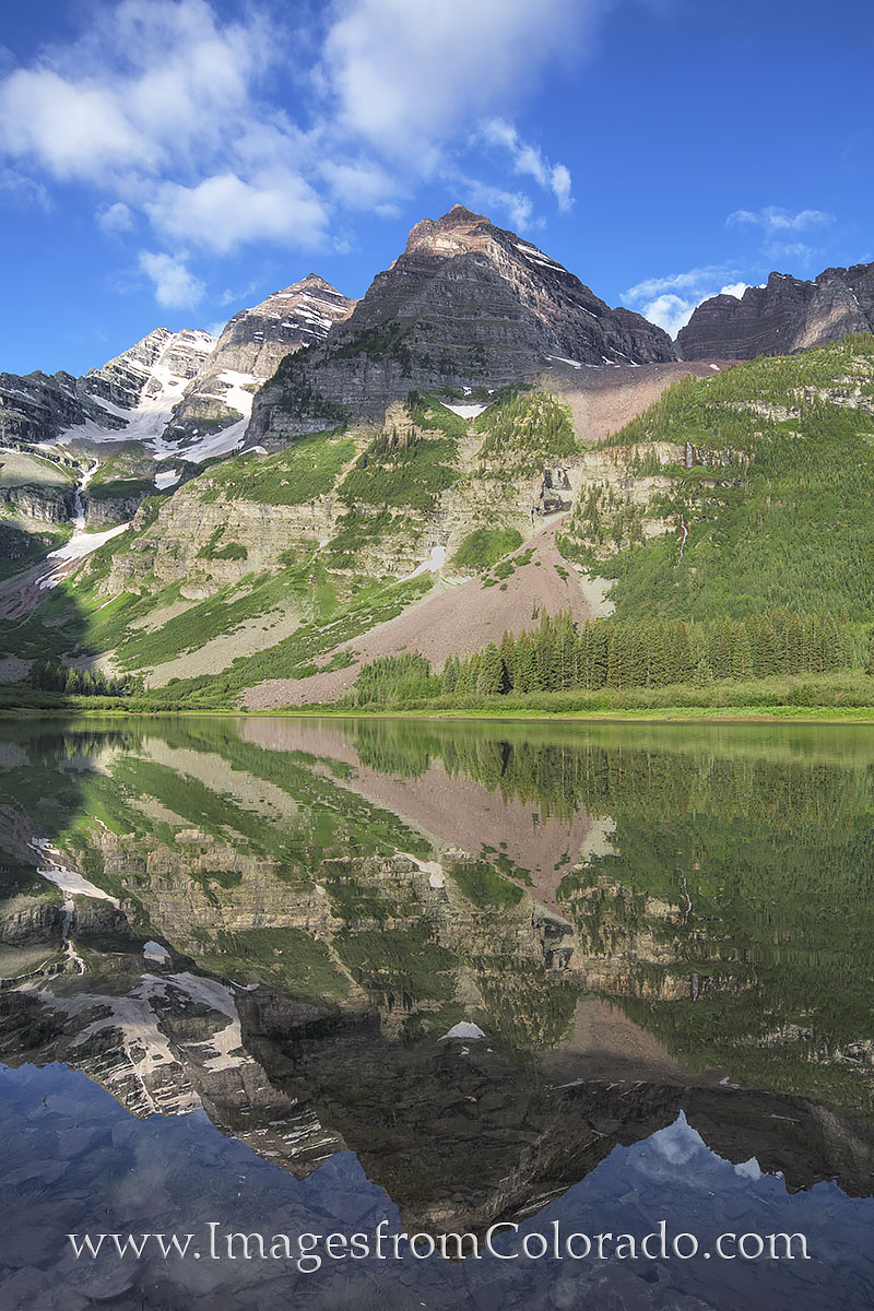 From Crater Lake, the grand Maroon Bells rise steeply into the clear blue Colorado sky. This lake is only around 2.3 miles from...