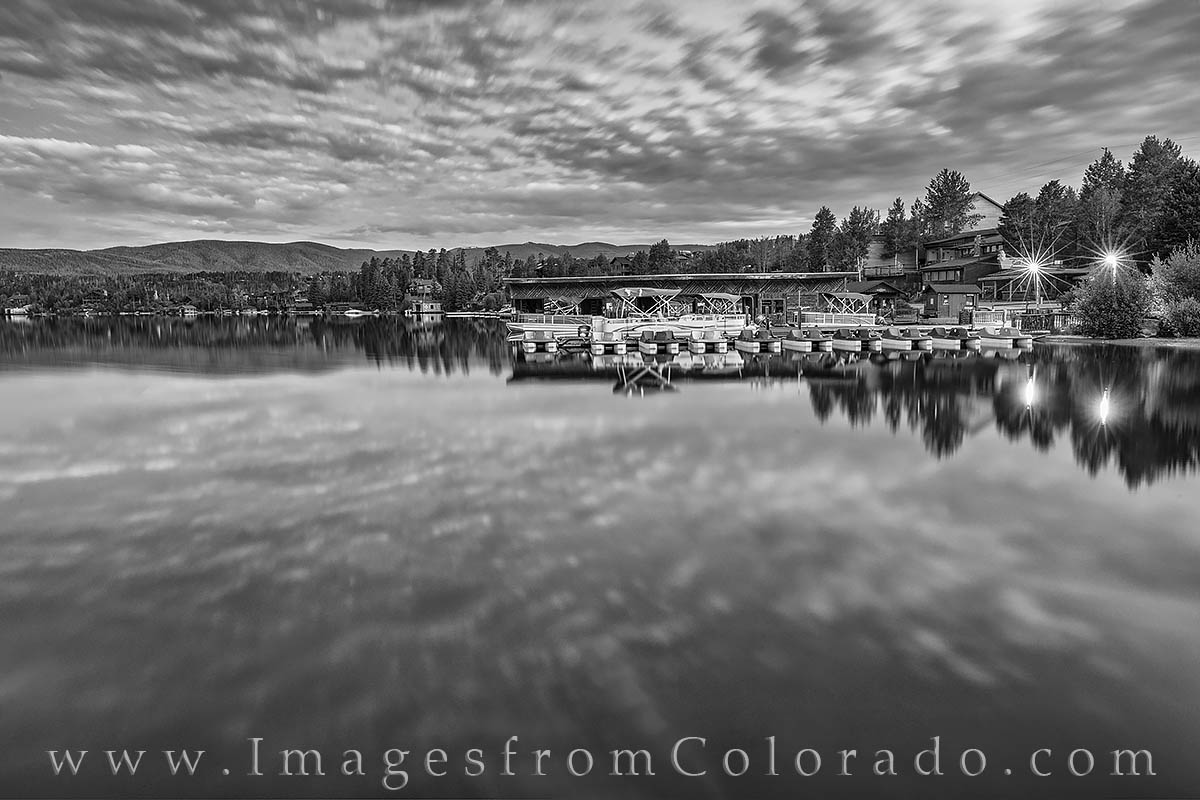 Clouds race across the sky about 30 minutes before sunrise in this long black and white exposure from Grand Lake, Colorado.