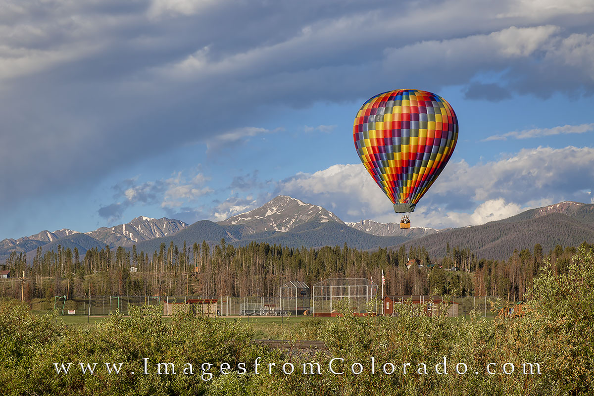 On a cold July morning, a hot air balloon takes sightseers up into the sky and gives them a birds-eye view of Winter Park, Fraser...