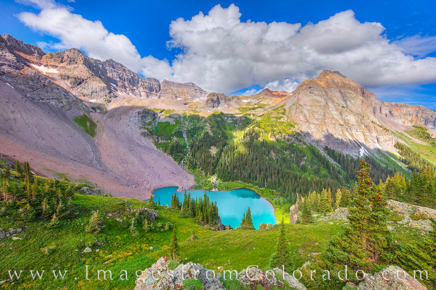 Not far from Ouray, the Blue Lakes Trail offers some of the best views in Colorado. Here, the Lower Blue Lake, turqoise from...