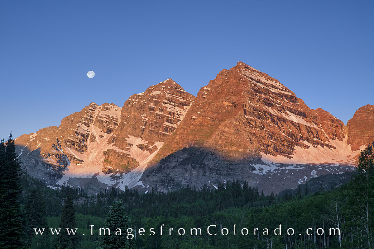 After arriving at Maroon Lake well before first light, I enjoyed watching the final descent of the full moon over Maroon Peak...