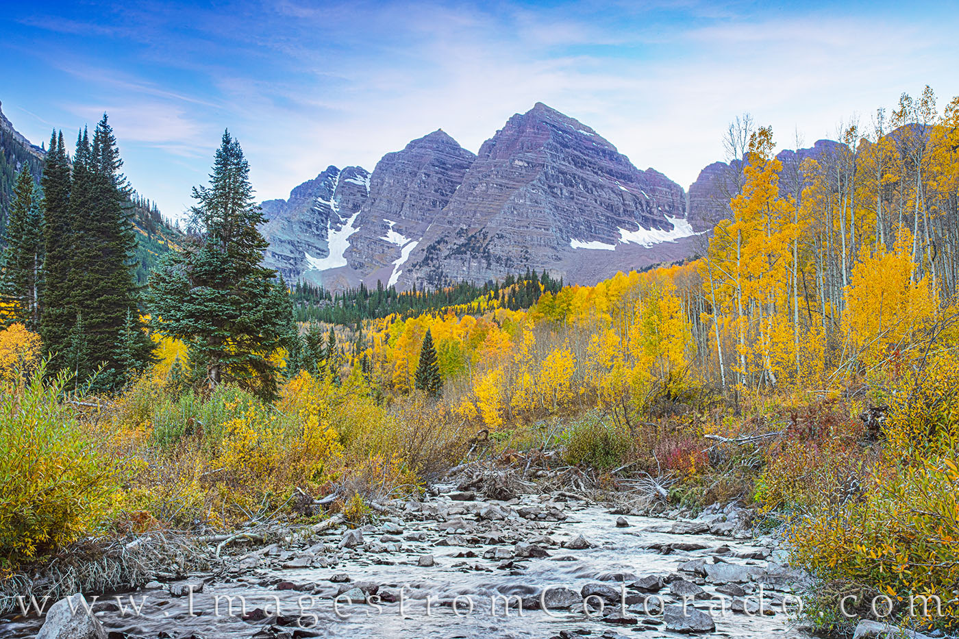 West Maroon Creek flows down from the higher elevations as the Maroon Bells Wilderness area shows off its fall colors. In the...
