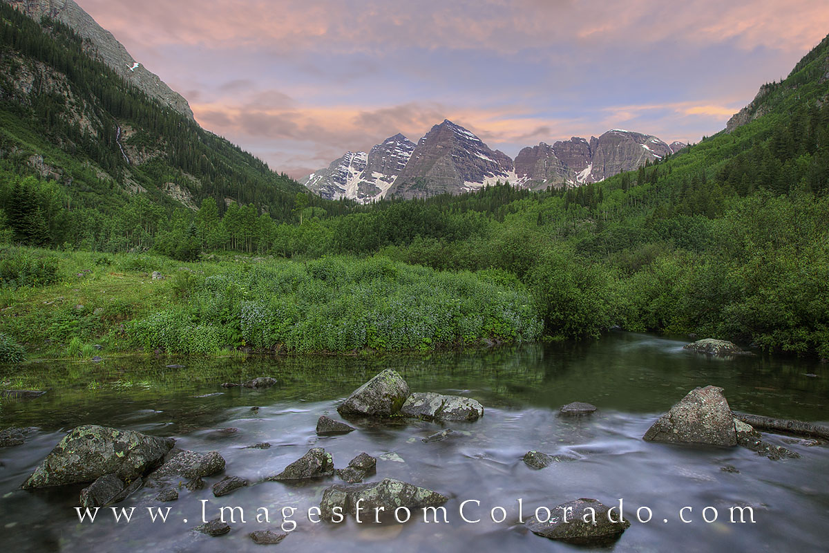 Soft light welcomes the morning at the Maroon Bells Wilderness area. This image was taken just above Maroon Lake. Water from...