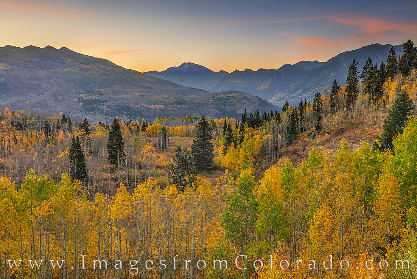 McClure Pass shows off its fall colors of gold, orange, and green under a beautiful morning sky. This photograph was taken on...