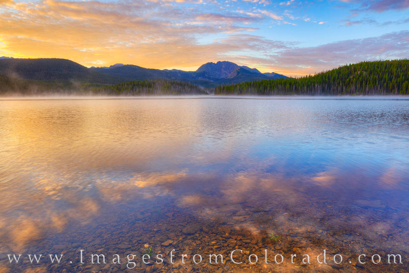Fog rolls off the water of Meadow Creek Reservoir on a cold summer morning.