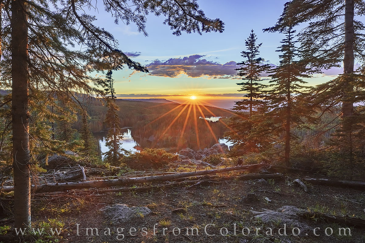 Through the pine trees high above Mesa Lake, this photograph shows the view looking across the the Mesa Lakes area and into the...