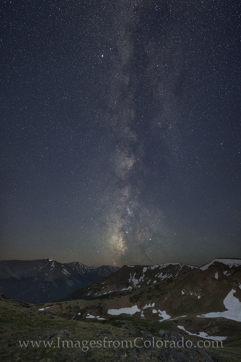 From a view along the Continental Divide Trail near Berthoud Pass, the Milky Way rises majestically above the Rocky Mountains...