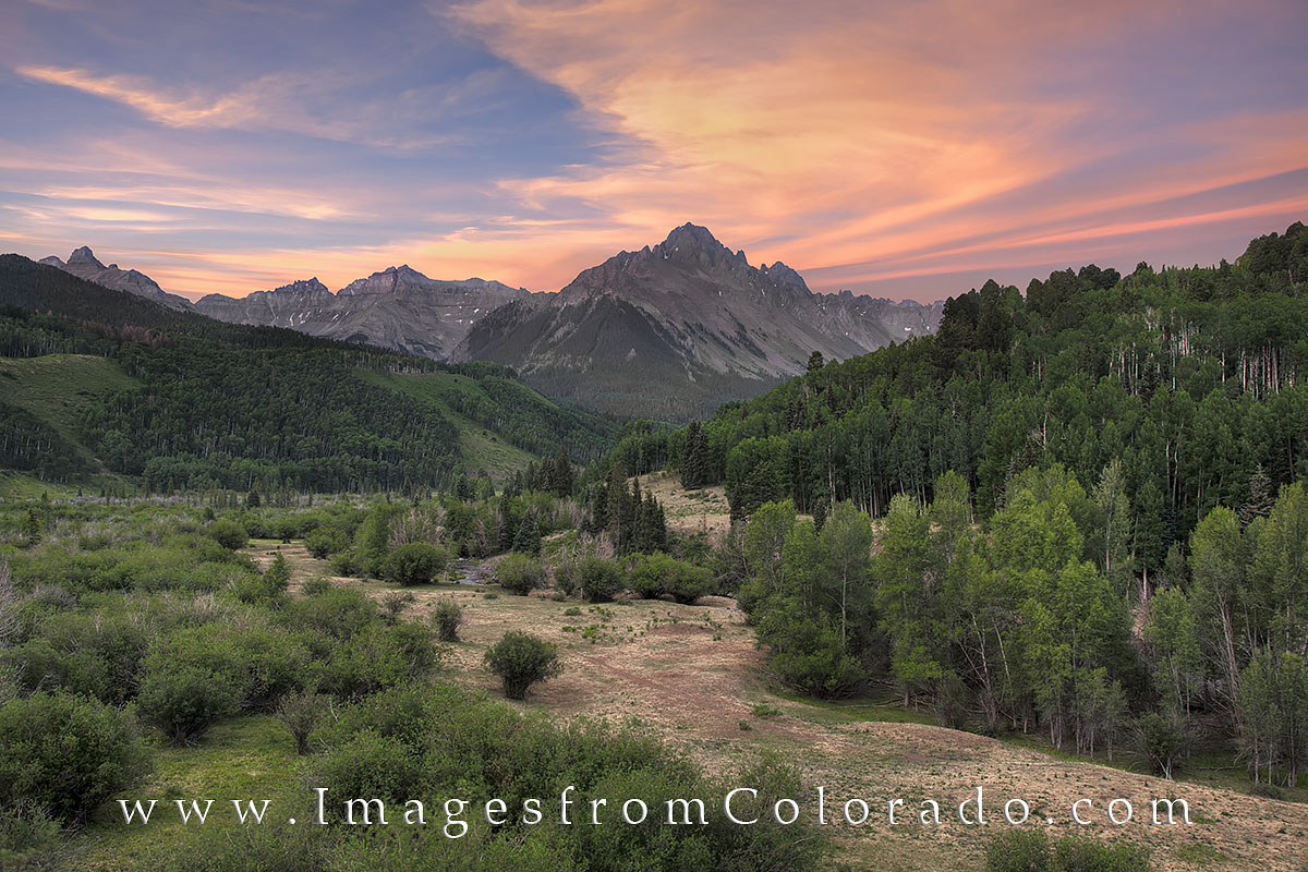 Mount Sneffels rises to 14,150' and dominates the skyline near Ouray, Colorado, in the San Juan Mountains. This photograph...