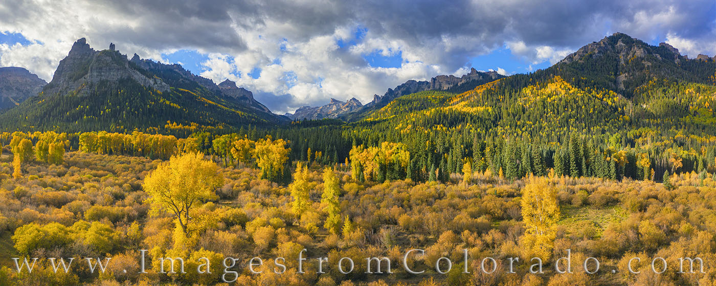 This Autumn panorama comes from the Cimarron area in the San Juan Mountains on the eastern side of Owl Creek Pass. The oak and...
