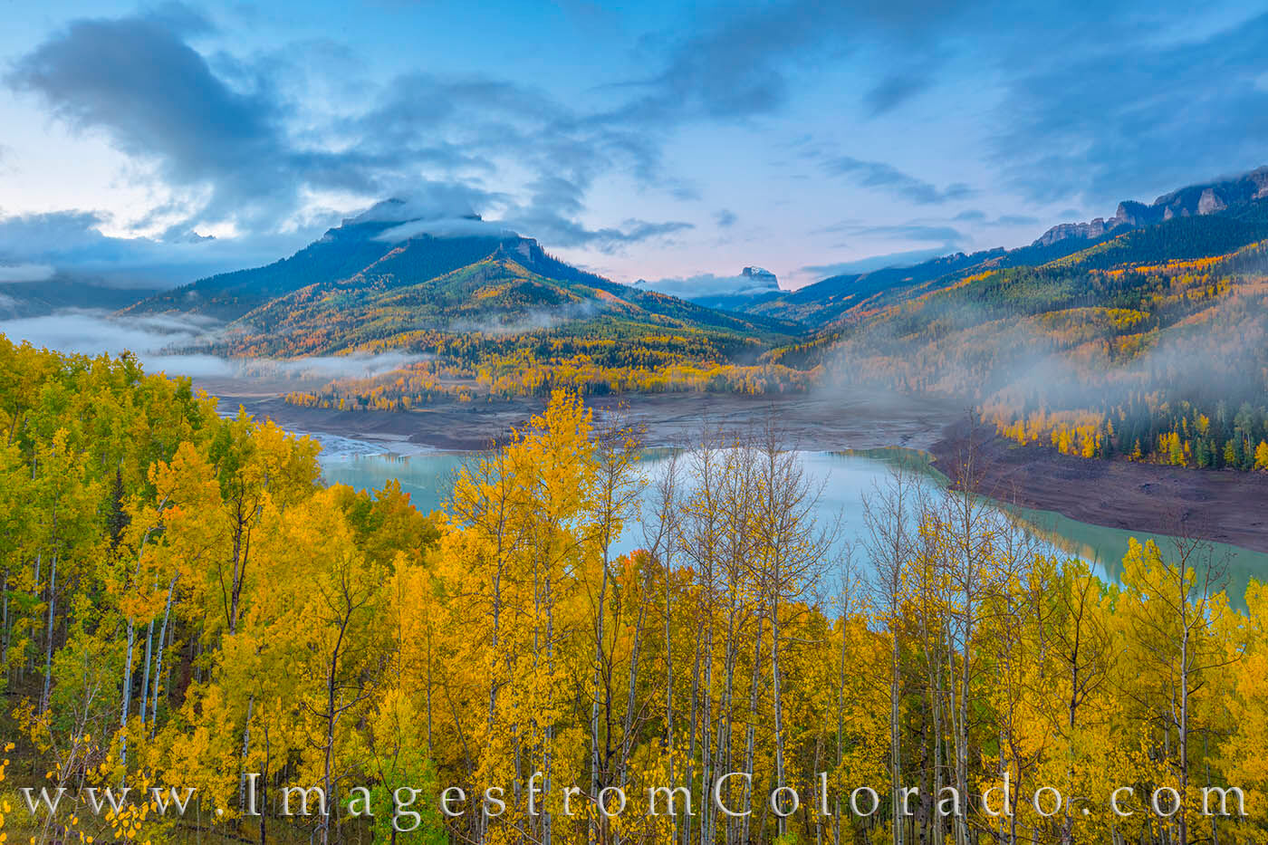 Golden aspen highlight this fall image taken from a ridge above Silver Jack Reservoir. The dirt road makes it easy to access...