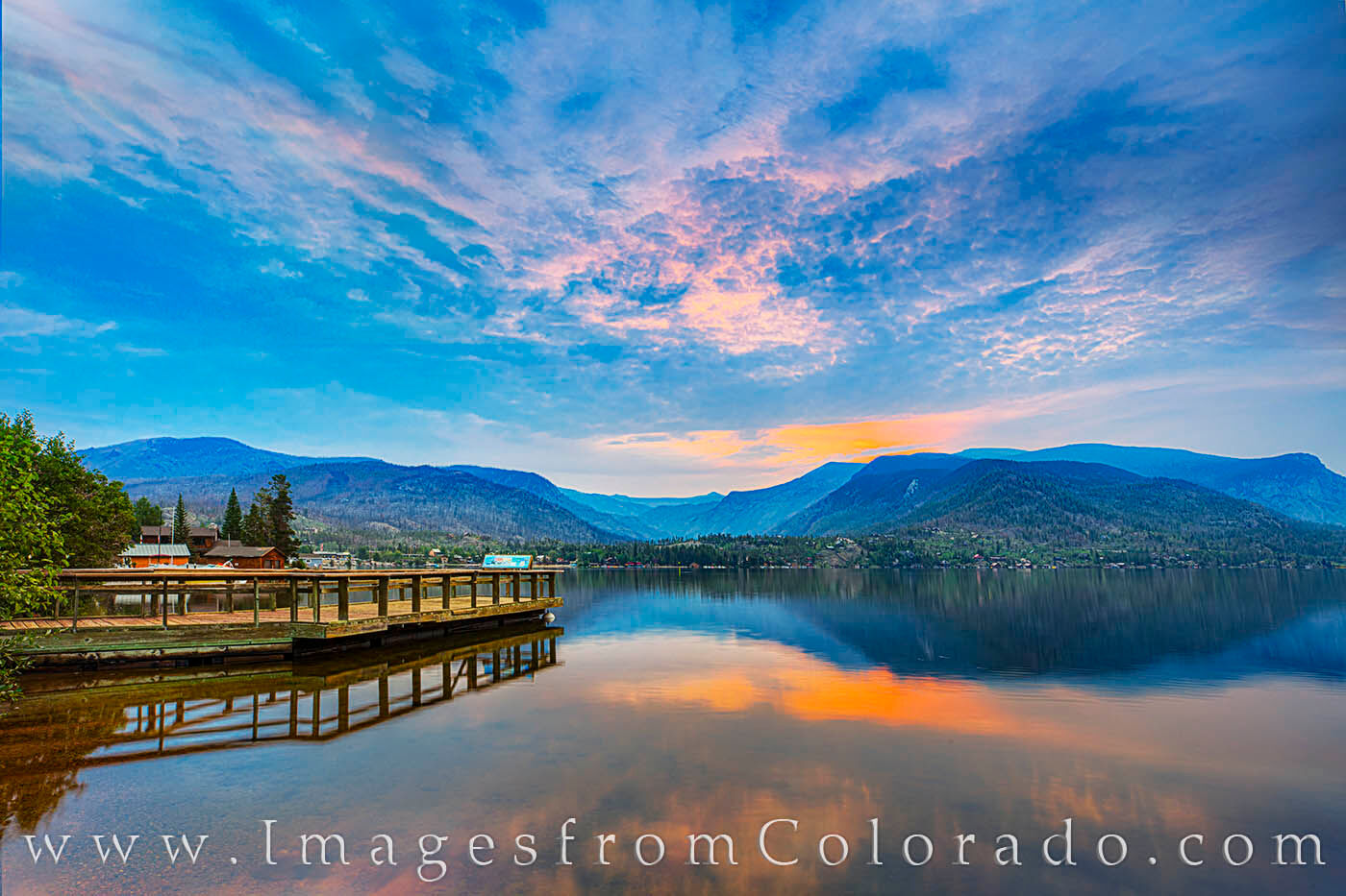 On a quiet morning in Grand Lake, Colorado, the quiet lake begins to brighten up as first light spreads across the still waters...