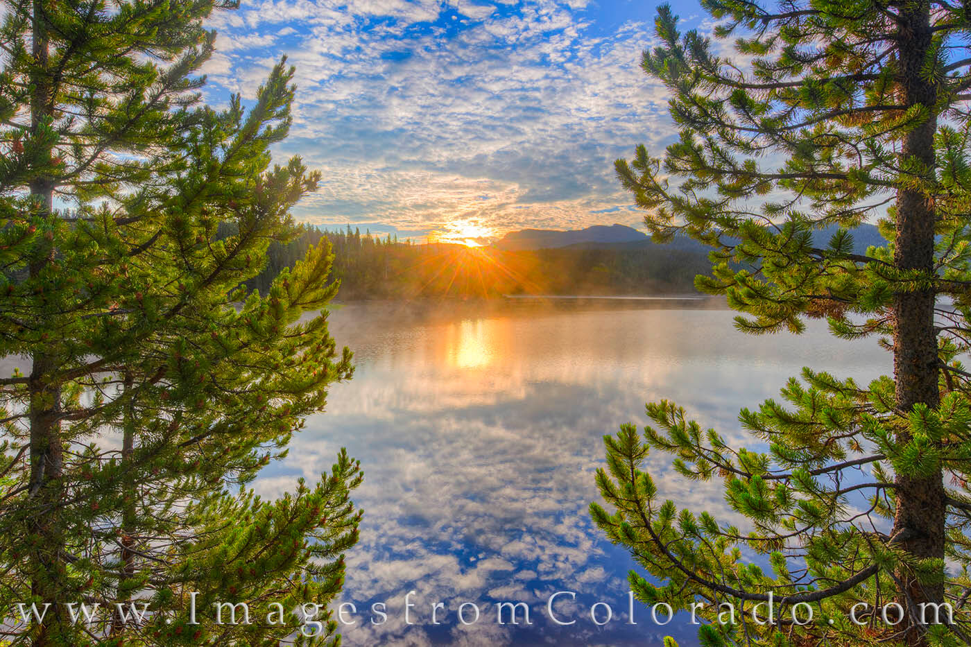 A beautiful morning greets the calm waters of Meadow Creek Reservoir in Grand County, Colorado.