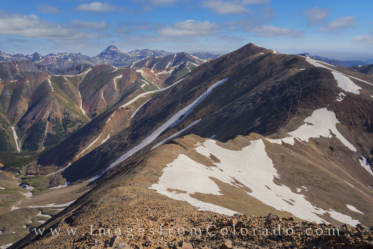 From the summit of Sunshine Peak (14,001'), this 14ers image looks back at Redcloud (14,034') and the trail that leads from...