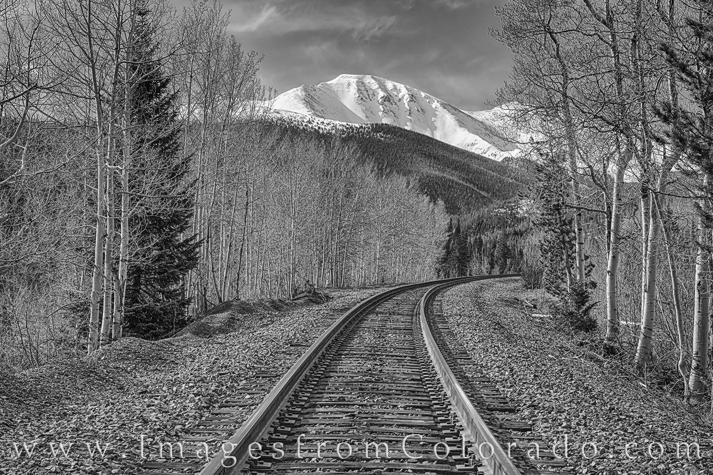 From just outside the resort town of Winter Park, Colorado, train tracks head towards the ski base and Continental Divide. With...