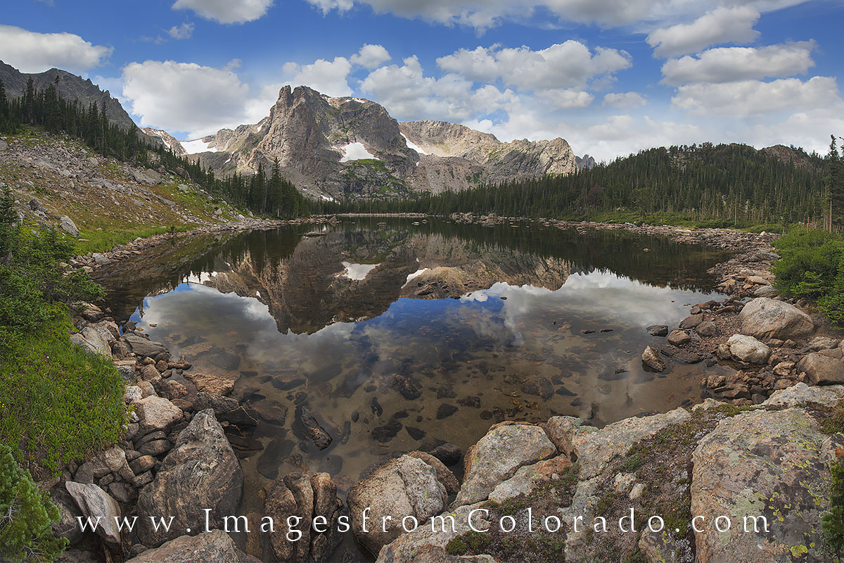 Two Rivers Lake is one of the many hidden treasures of Rocky Mountain National Park. On a trail several miles from Bear Lake...