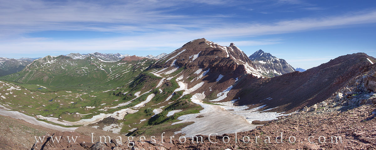 West Maroon Pass connects Crested Butte to Aspen. This panorama shows the pass on the right with the Maroon Bells, two of Colorado...