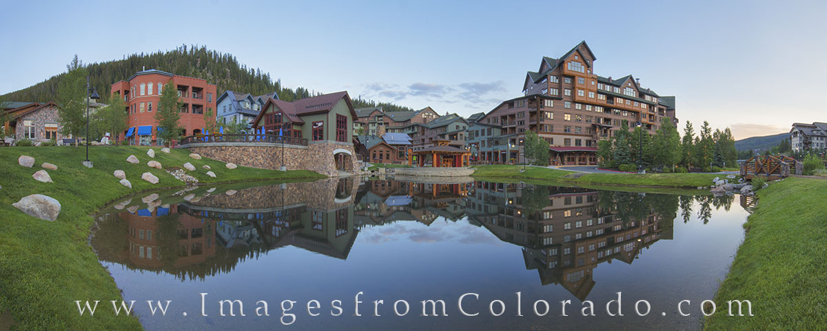 Summer mornings in Winter Park, Colorado, are beautiful. This panorama shows the small pond in front of Winter Park Village during...