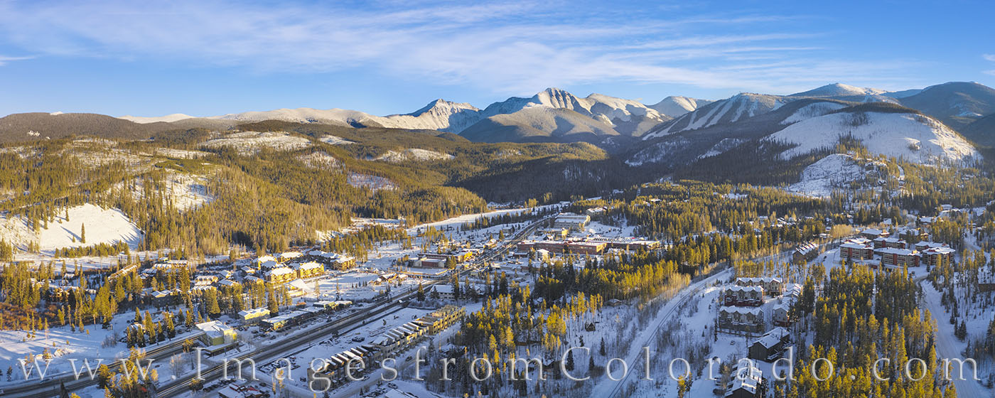This aerial view of Winter Park, Colorado, was taken looking south back a the ski base and distant Berthoud Pass. Highway 40...