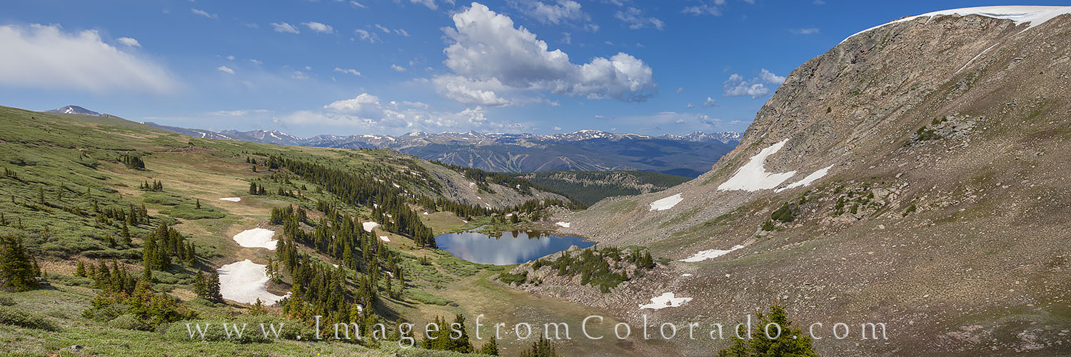 From high above the resort town of Winter Park, Colorado, this panorama shows Deadman's Lake on a cool July morning. In the...