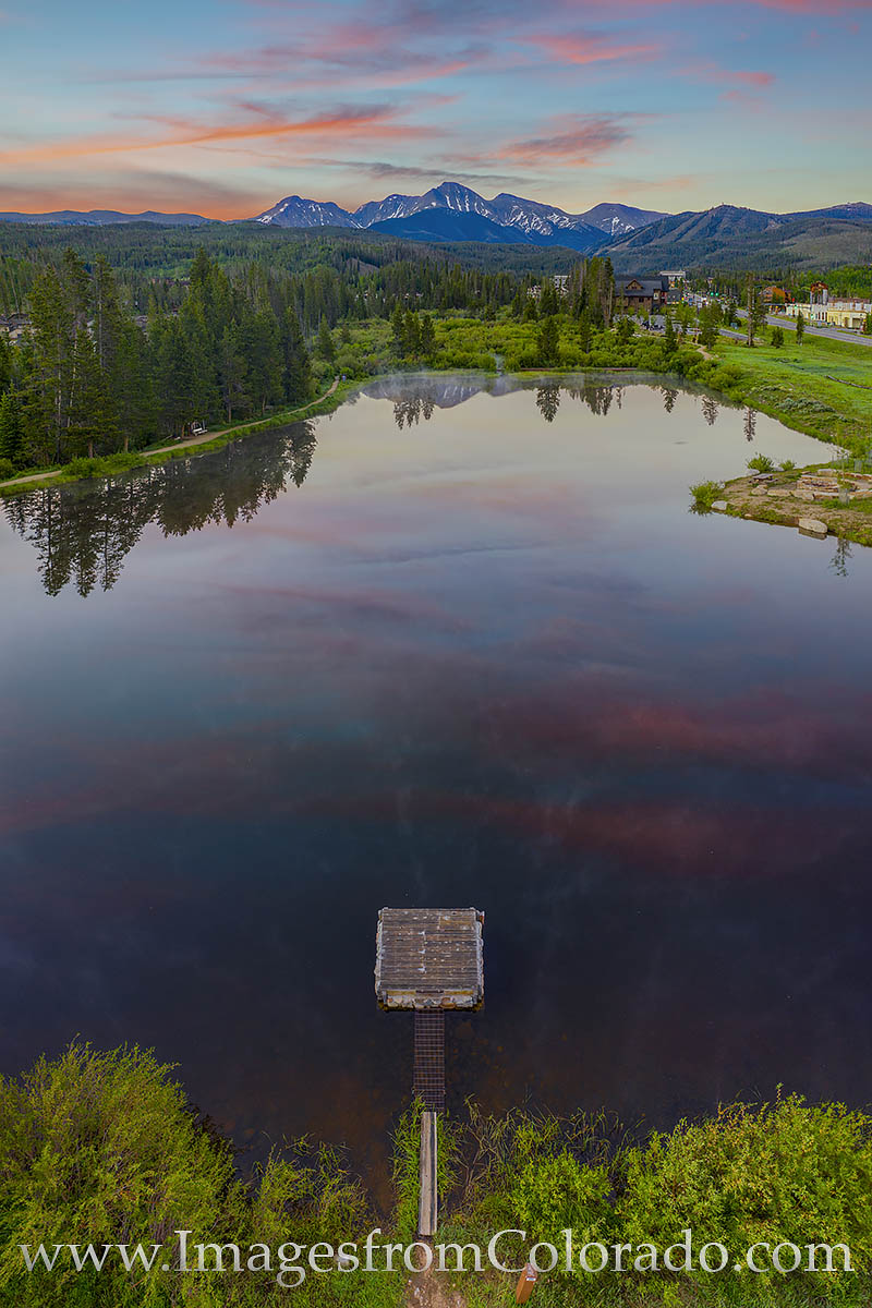 From about 100 feet above this tranquil pond, the reflection of Parry Peak (13,397') and the Continental Divide are seen on...