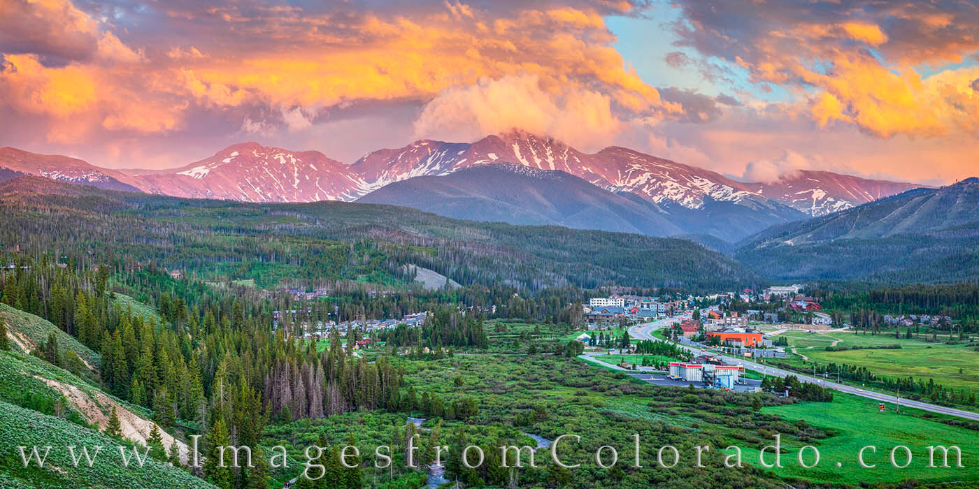Brooding clouds light up over the Continental Divide and Winter Park, Colorado. This panorama shows Highway 40 as it winds north...
